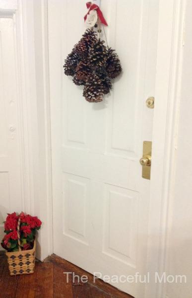 DIY Pine Cone Swag Door View - The Peaceful Mom