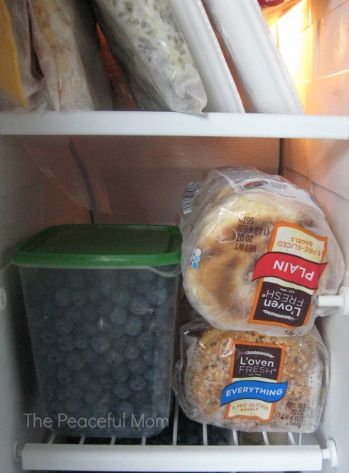 How to Freeze Blueberries - Place frozen berries in an airtight container - The Peaceful Mom