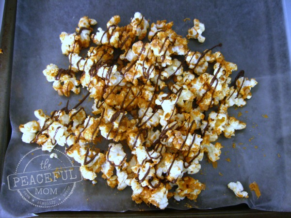 Gourmet Butterscotch Toffee Popcorn -- Drizzle chocolate over popcorn -- The Peaceful Mom